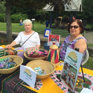 A Partnership in Caring's Carolyn Rideout and Maria van Vonderen at the Art Fair in Antigonish this Summer.